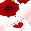 Two red roses and love letter — Stock Photo