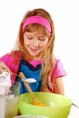 Young girl helping in baking cake — Stock Photo
