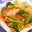 Fried halibut with vegetables for dinner — Stock Photo #4955738