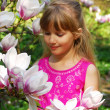 Young girl with magnolia — Stock Photo #4955918