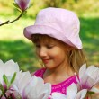 Young girl with magnolia — Stock Photo
