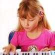 Little girl playing piano keyboard — Stock Photo #4956467