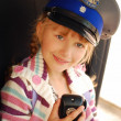 Stock Photo: Young girl in police hat
