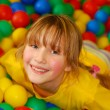 Stock Photo: Happy girl in ball pool