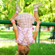 Young girl doing somersault — Stock Photo #4956913
