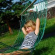 Relaxing in hammock — Stock Photo #4957102