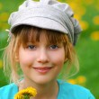 Young girl with dandelions — Stock Photo #4957664
