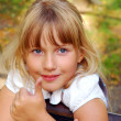 Young girl showing OK sign - Stock Photo