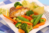 Fried halibut with vegetables for dinner — Stock Photo