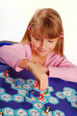 Little girl playing the board game — Stock Photo