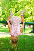 Young girl doing somersault — Stock Photo