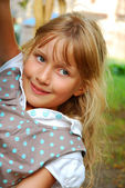Young girl `s outdoor portrait — Stock Photo