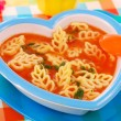 Tomato soup with pasta for child — Stock Photo