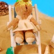 Teddy bear relaxing on the beach — Stock Photo
