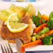 Fried halibut with vegetables for dinner — Stock Photo #5044772