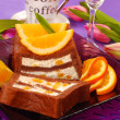 Chocolate cake with cream and oranges — Stock Photo