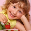 Little girl and strawberries — Stock Photo