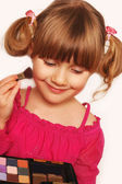 Little girl and make up — Stock Photo