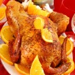 Roasted whole chicken with oranges — Stock Photo #5237470