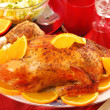 Roasted whole chicken with oranges — Stock Photo