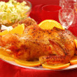 Stock Photo: Roasted whole chicken with oranges