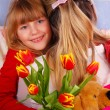 Stock Photo: Girl with bouquet of tulips for mummy
