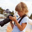 Young photographer on vacation - Stock Photo