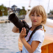 Young photographer on vacation — Stock Photo
