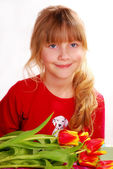 Girl with bouquet of tulips — Stock Photo