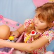 Stockfoto: Little girl playing with baby doll