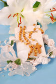 Prayer book and rosary for first holy communion — Stock Photo
