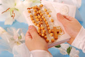 First holy communion-prayer book and rosary — Stock Photo