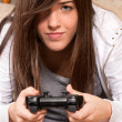Young female concentrating playing videogames close-up on sofa at home — Stock Photo