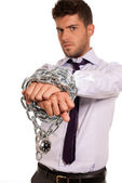 Businessman chained with padlock, job slave symbol, isolated on white backg — Stock Photo