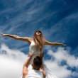 Young couple dancing on sky background, freedom and relax symbol — Stock Photo