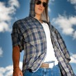 Young man urban fashion portrait over sky background — Stock Photo