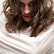 Young insane woman with straitjacket looking at camera close-up portrait — Stock Photo
