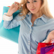 Young woman with shopping bags isolated on white background - Stock Photo