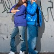 Young couple urban fashion standing portrait — Stockfoto