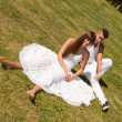 Young couple happy sitting on grass white clothes, love relationship — Foto de Stock