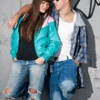 Young couple urban fashion standing portrait — Стоковое фото