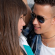 Stock Photo: Young couple urban fashion flirting close-up portrait