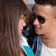 Young couple urban fashion flirting close-up portrait — Stock Photo