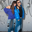 Young couple urban fashion standing portrait — Stock fotografie #4418761