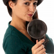 Young woman with magnifier glass and hat looking to camera isolated on whit — Stock Photo