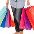 unrecognizable woman with shopping bags isolated on white background — Stock Photo