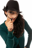Young woman looking through magnifying glass loupe detective isolated on wh — Stock Photo
