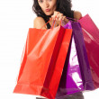 Young woman with shopping bags standing isolated on white background — Stock Photo