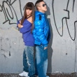 Young couple urban fashion standing portrait — Stock Photo
