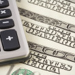 Calculator on US dollars background — Stock Photo
